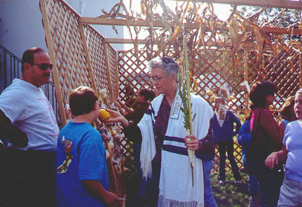 Ron Seidorf, Michael Ganz, Rabbi Lewis at the Sukkah